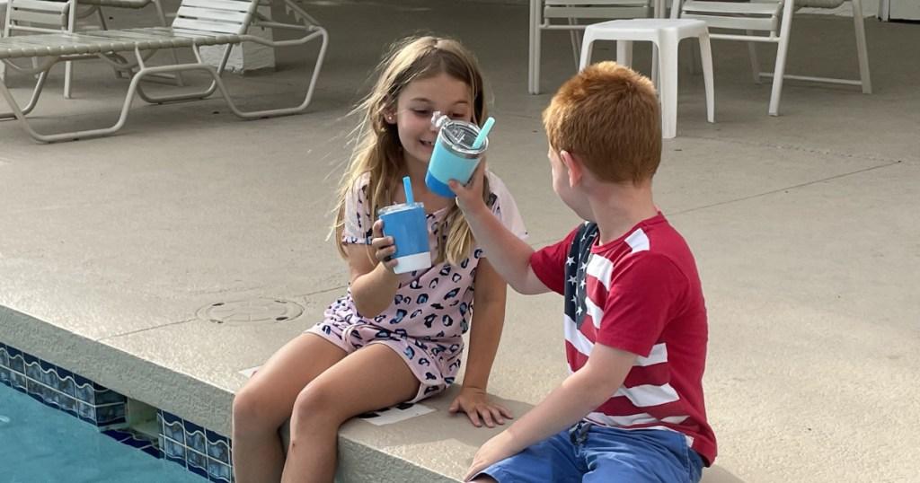 kids w: cups near pool