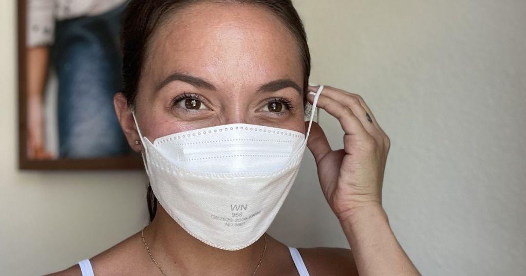 woman wearing white KN95 face mask