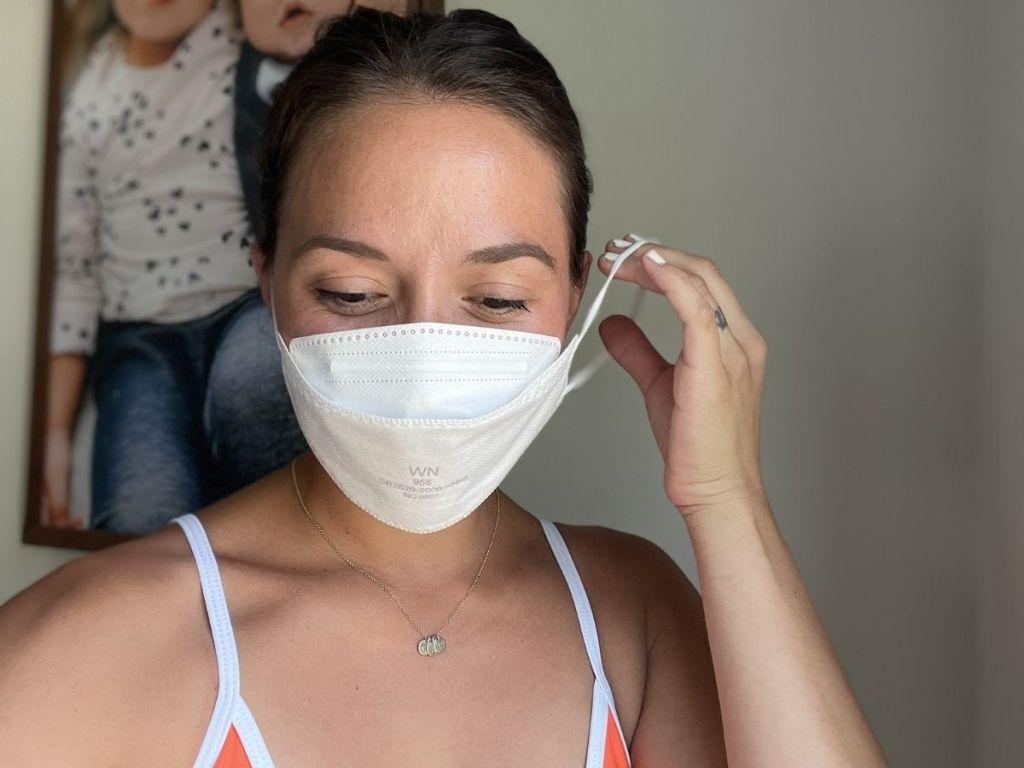 woman wearing white KN95 mask