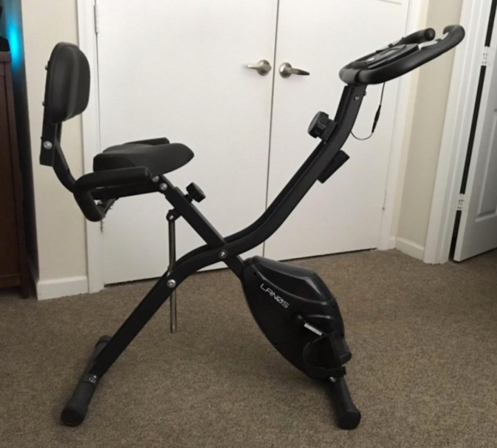 black exercise bike sitting inside in room