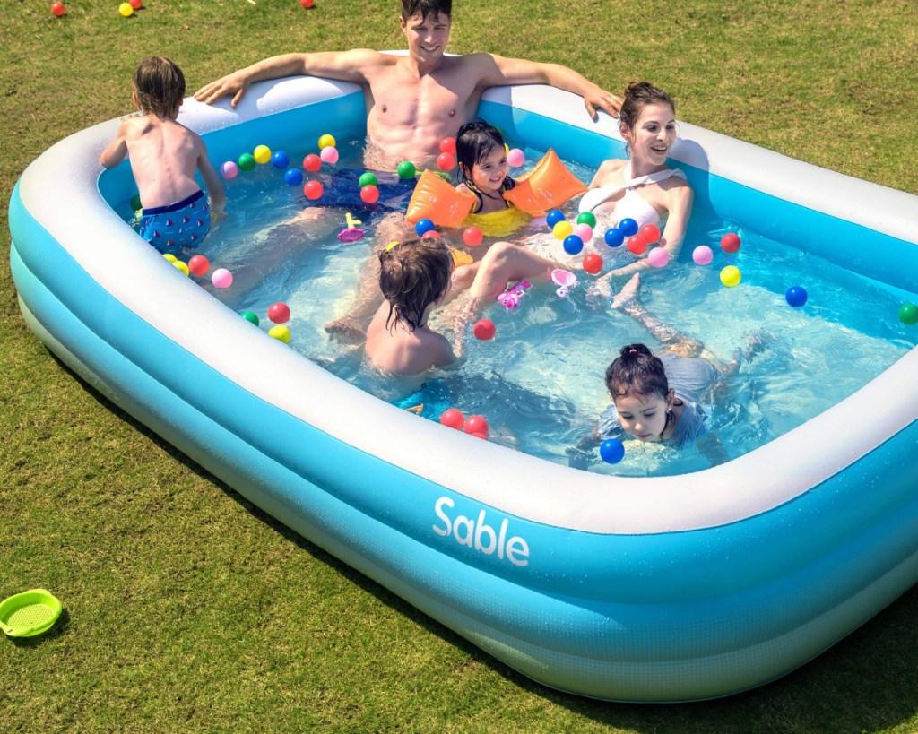 large sable pool w/ people swimming