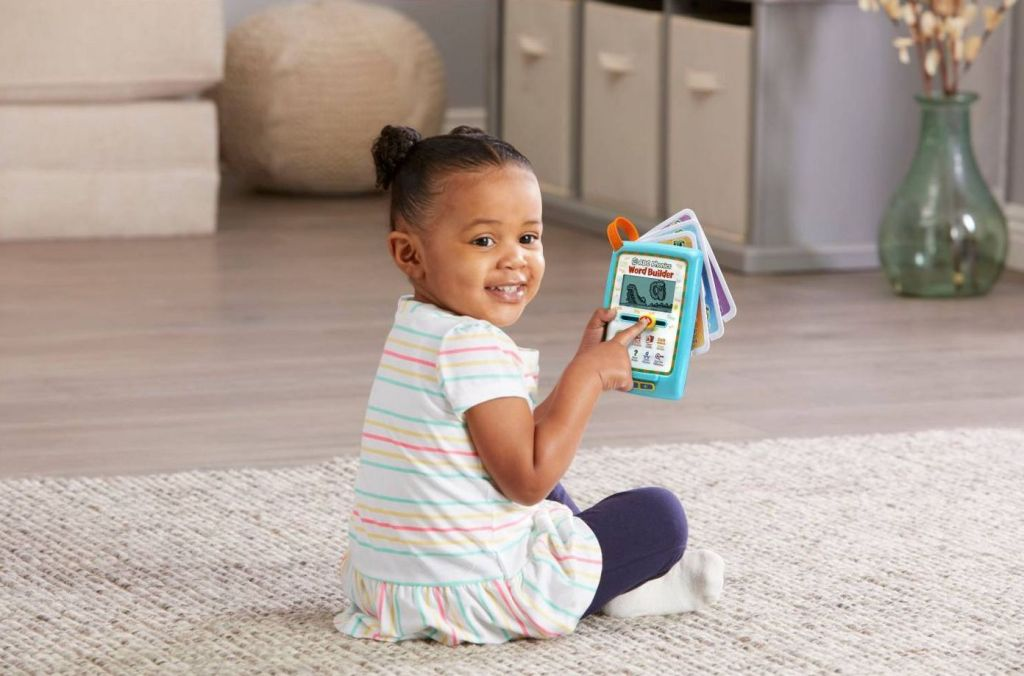 girl playing with leapfrog word builder