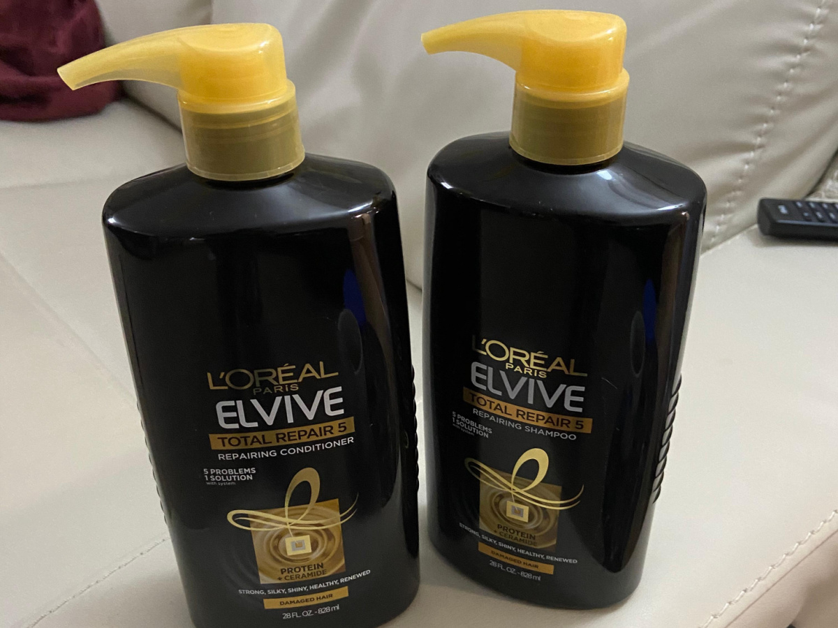 2 black and gold shampoo and conditioner bottles