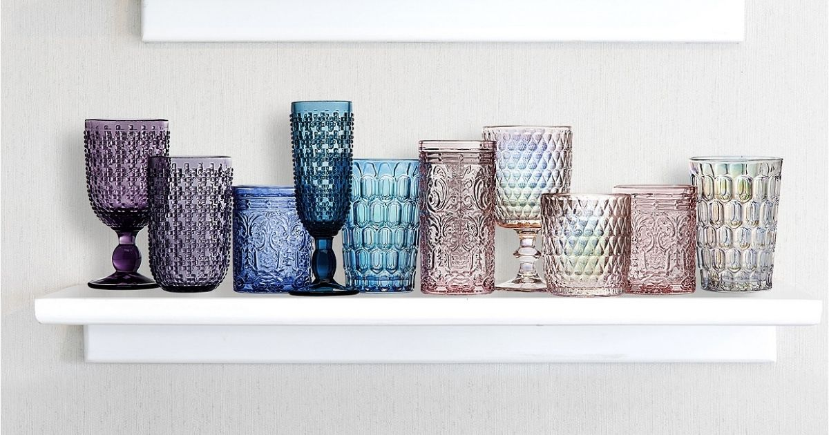 colorful glassware on white shelf