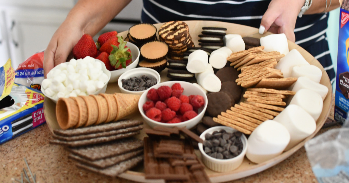 assorted marshmallows, chocolate, and cookies on a platter