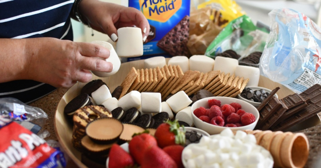 making a charcuterie board with s'more fixings