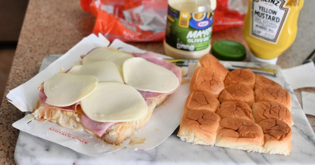 making mini sandwiches using hawaiian rolls