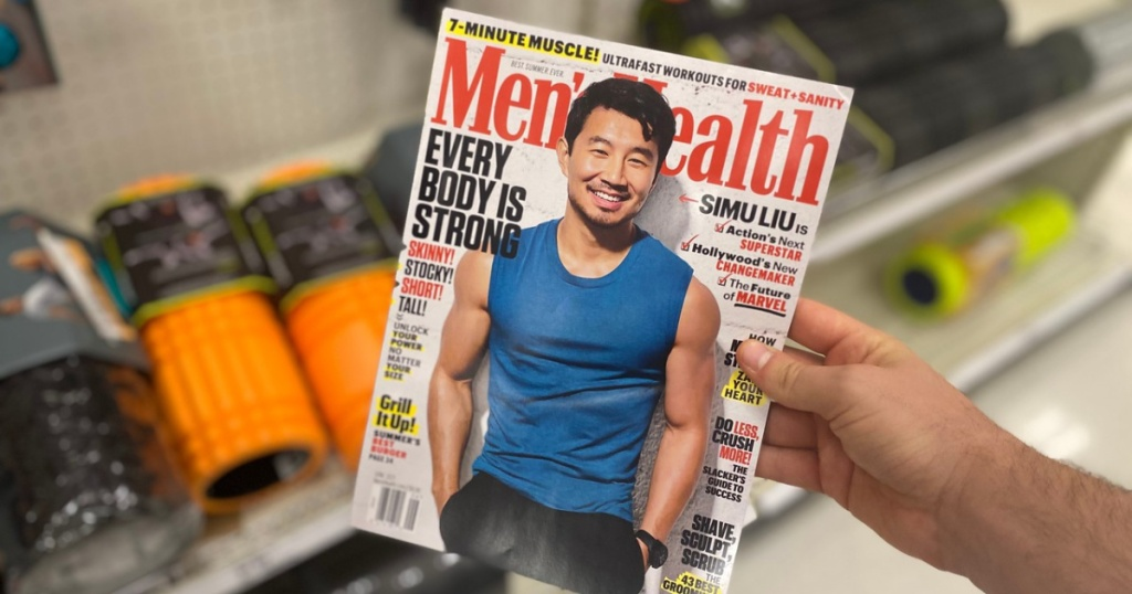 arm holding men's magazine in store