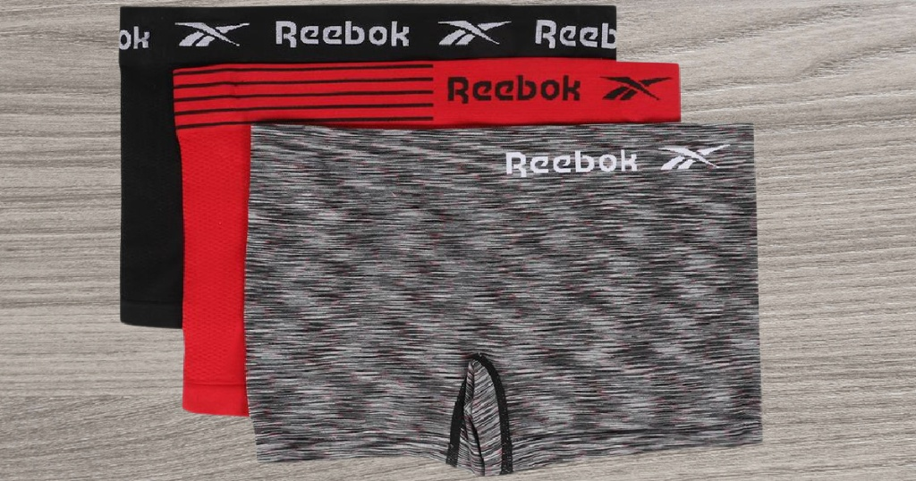 black, red, and black gray and red Reebok boy shorts