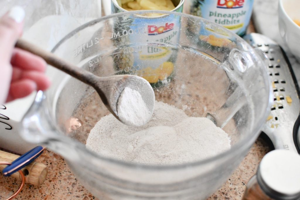 mixing flour and sugar in a mixing bowl