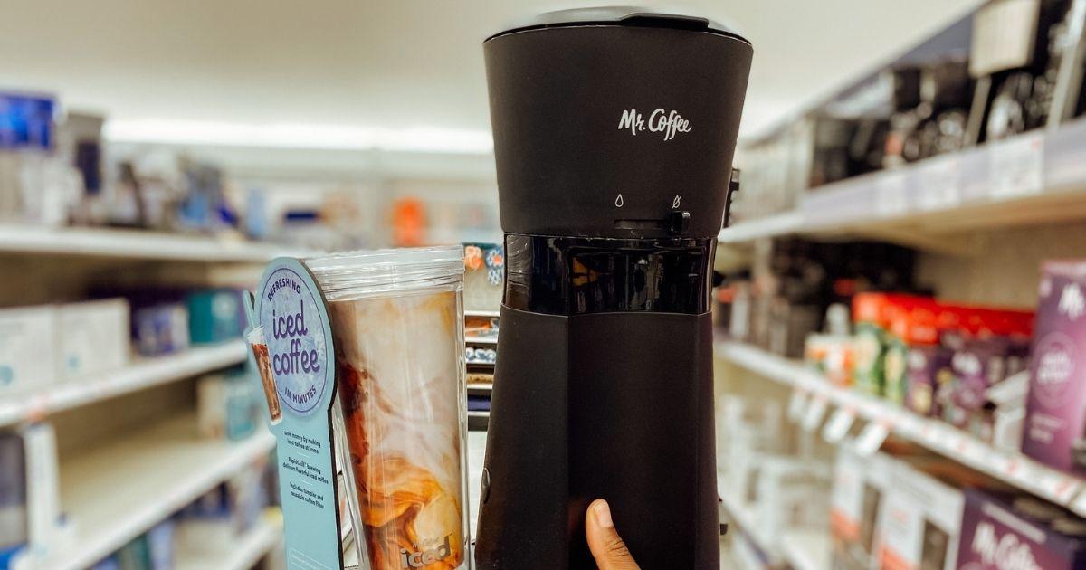 hand holding Mr. Coffee machine in store