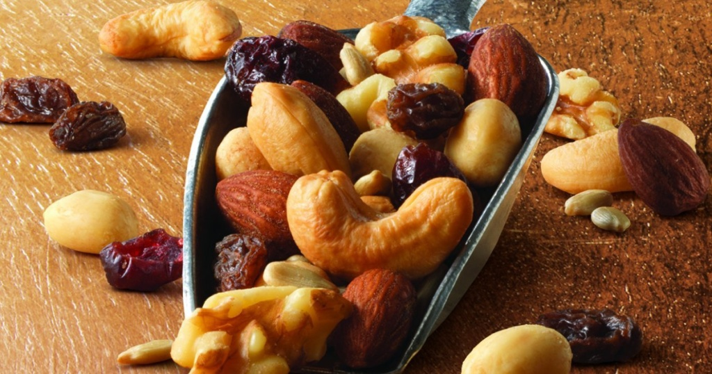 nuts and dried fruit in a metal scoop