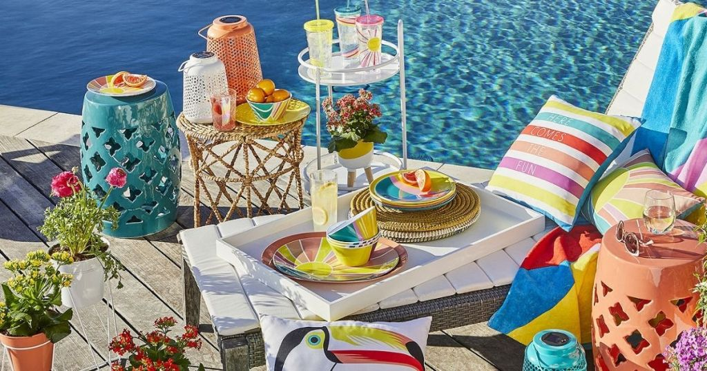 colorful lanterns and planters on deck by pool