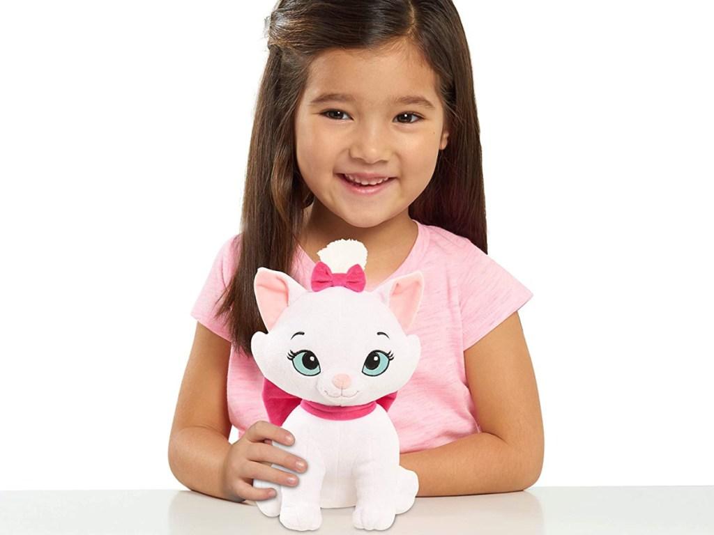 little girl holding stuffed cat