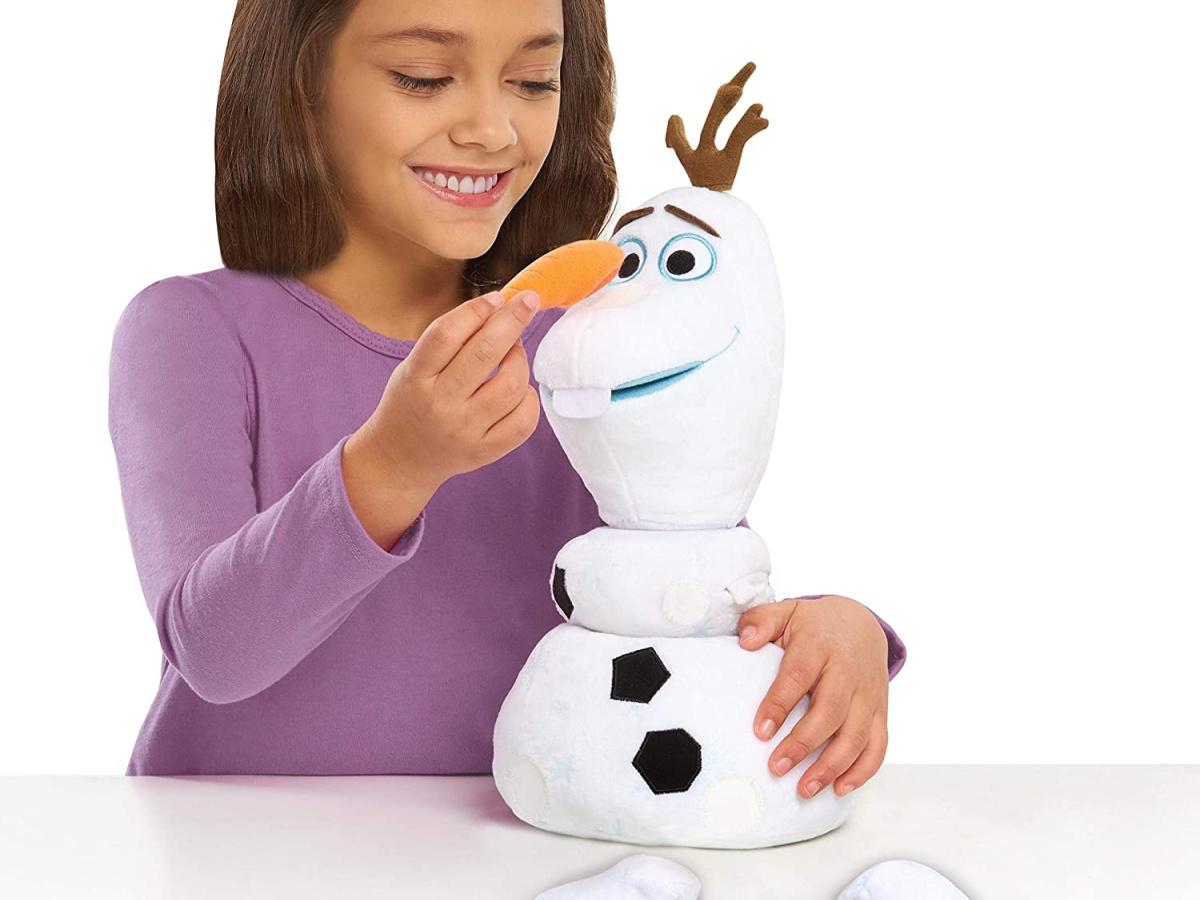 girl building plush snowman