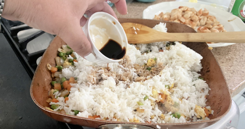 pouring soy sauce over rice