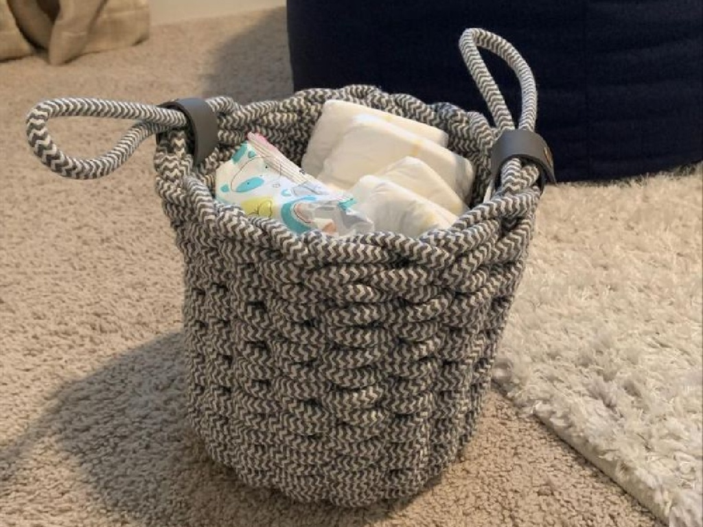 basket holding diapers and wipes
