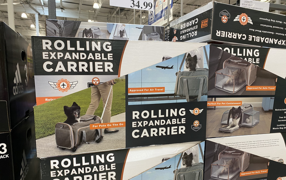 boxes of pet carriers on display at costco