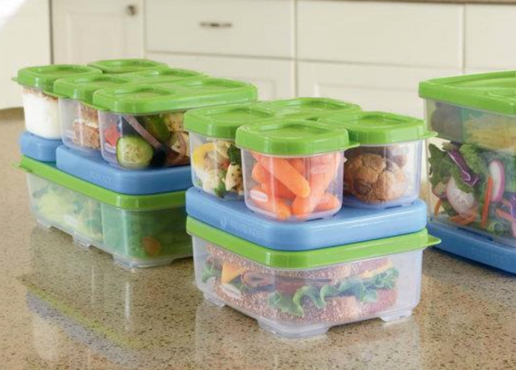 stacks of rubbermaid plastic containers with blue ice packs on counter