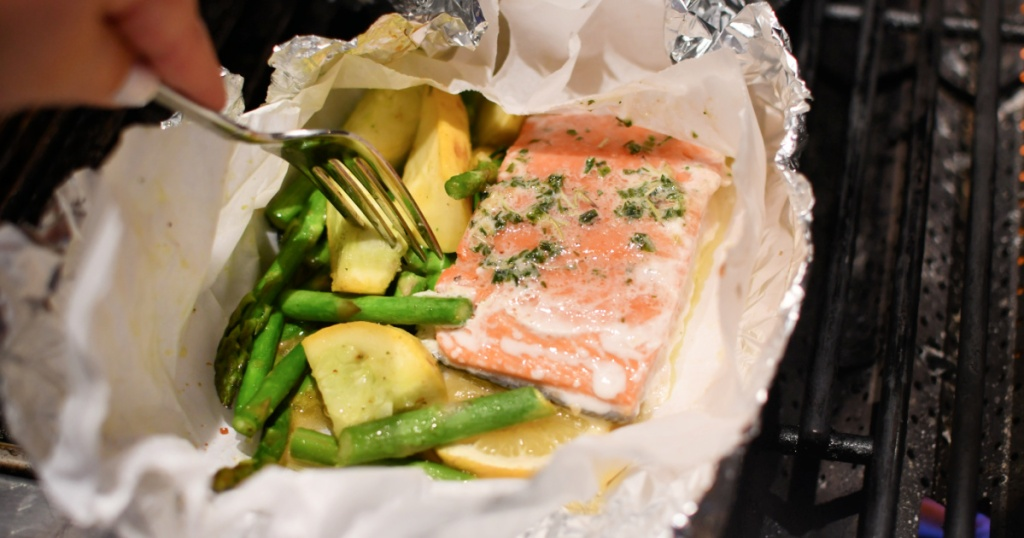 salmon and veggies foil packet meal on the grill