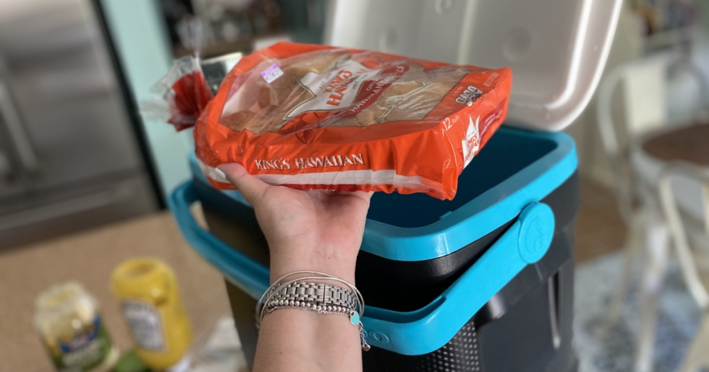 Hawaiian roll sandwiches on top of the cooler