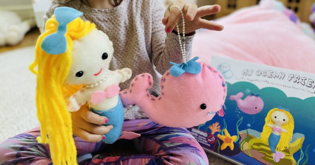girl doing sea creatures sewing kit