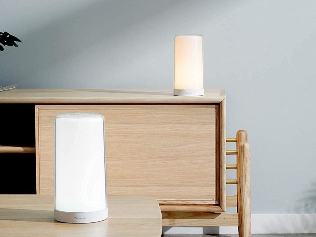 two lamps on a table and dresser