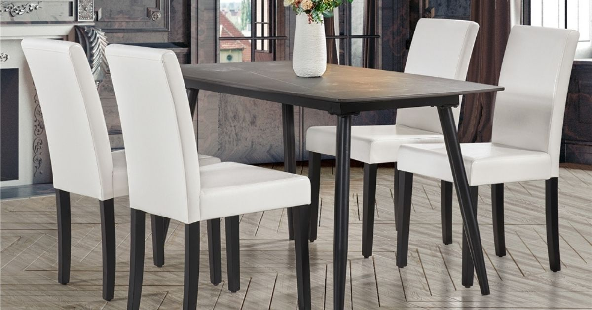 black dining room table and white chairs
