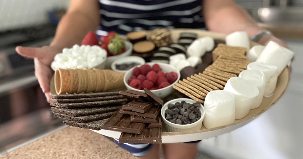 holding up S'mores charcuterie board