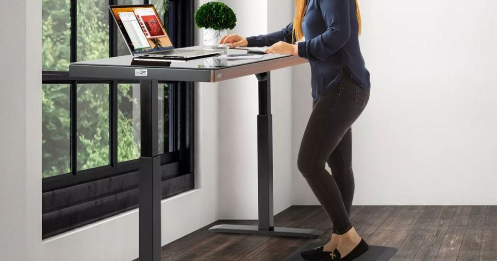 woman standing in front of desk
