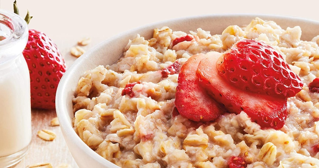 bowl of oatmeal with strawberries on it