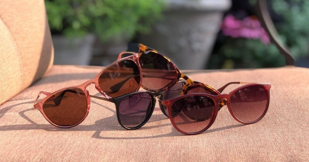 various sunglasses on lounge chair