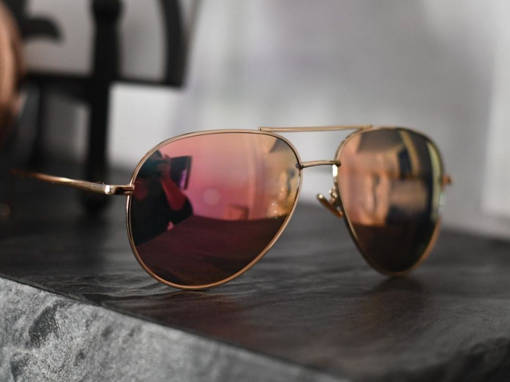 mirrored aviator sunglasses on table