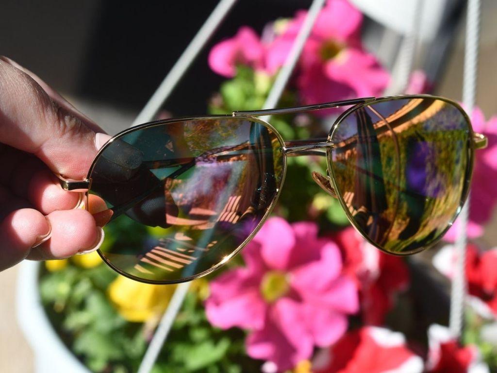 hand holding aviator sunglasses