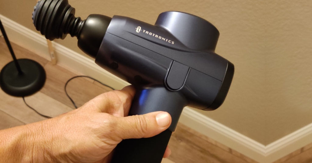 taotronics massage gun in hand