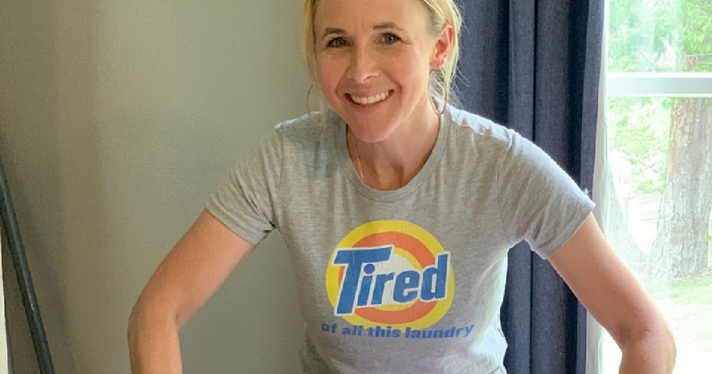 woman wearing a shirt that says tired of all this laundry on the front