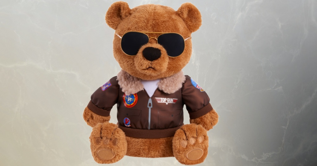 Teddy bear wearing aviator jacket and aviator sunglasses