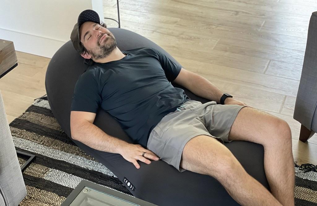 man laying down on moon pod