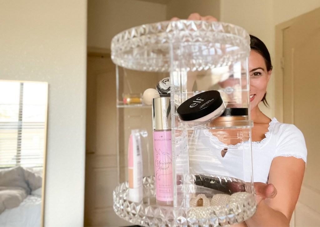woman holding makeup organizer