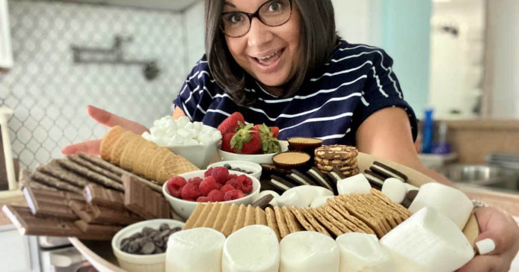 woman holding s'mores charcuterie board