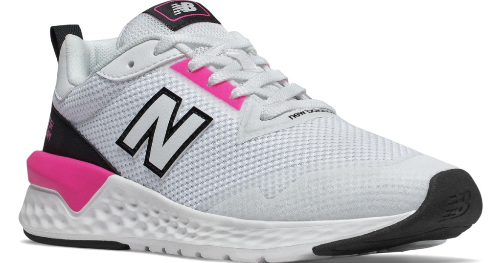 woman's white tennis shoe with pink on it