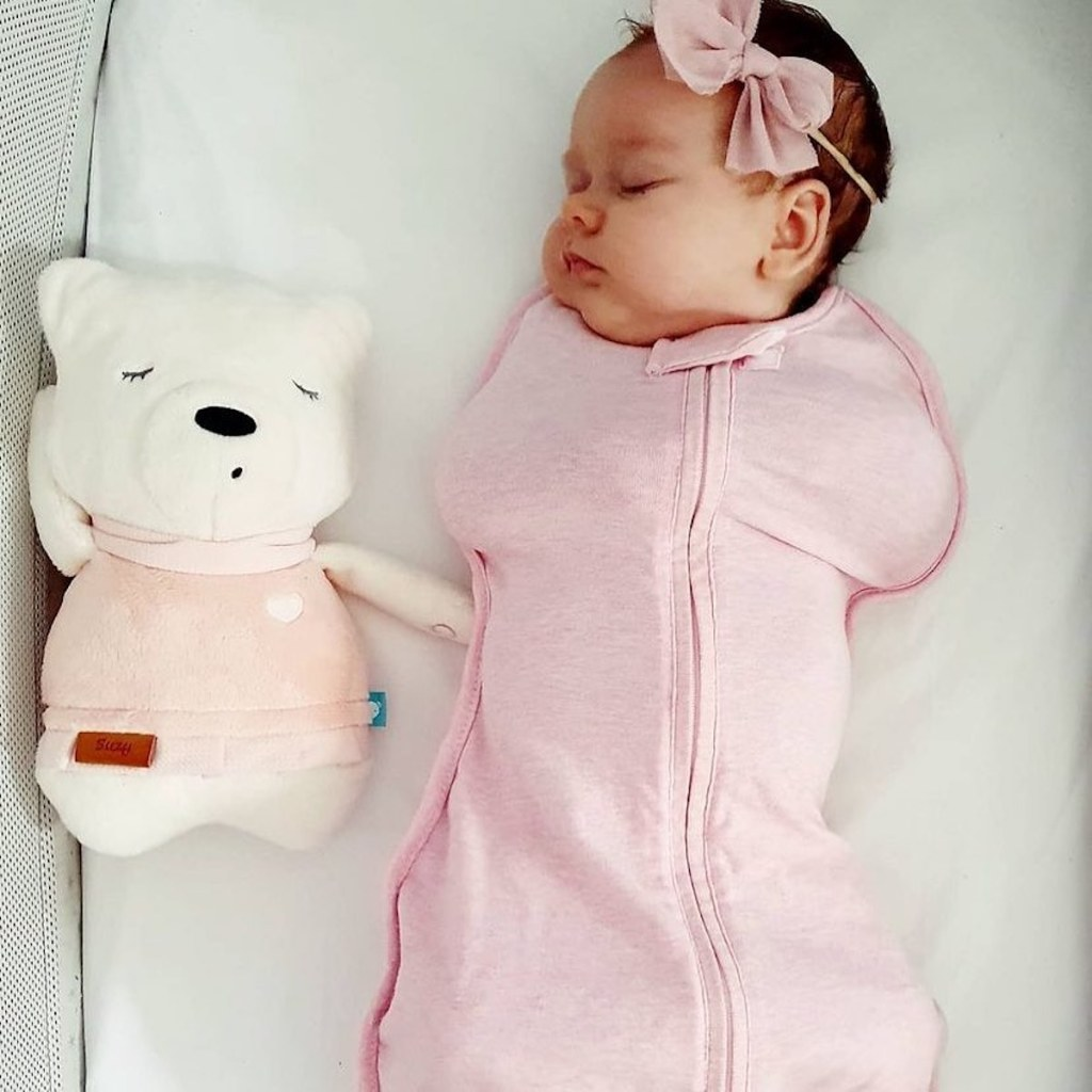 baby wearing pink swaddle while sleeping