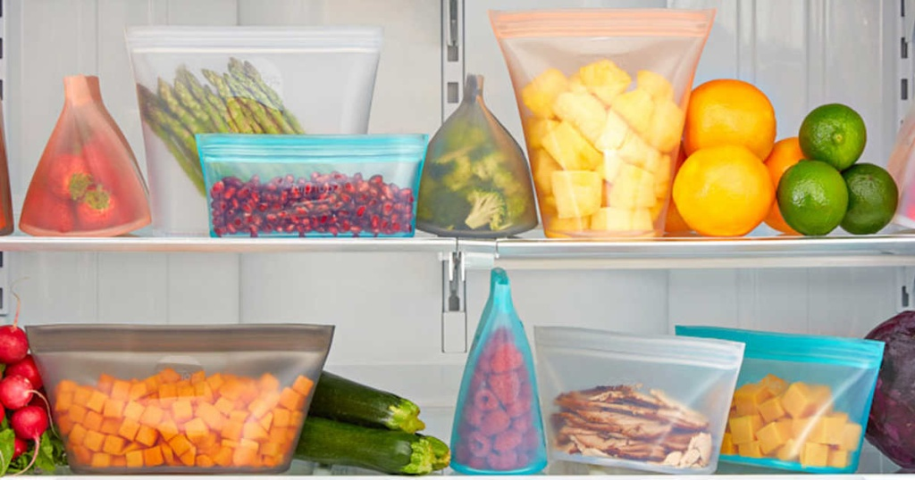 containers with food inside fridge