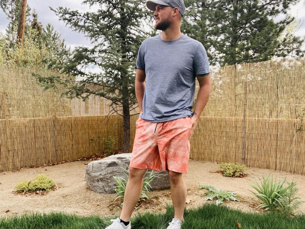man wearing orange 32 degrees swim shorts