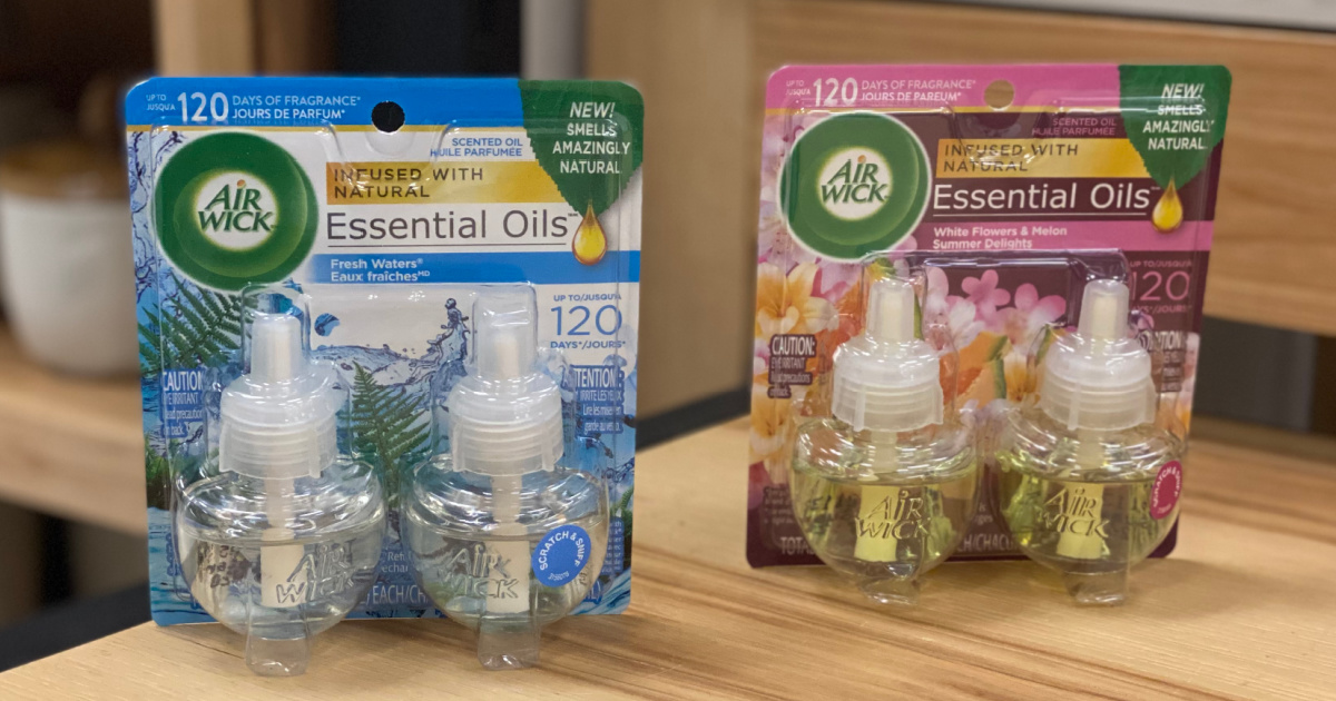 two packs of Air Wick scented oil refills