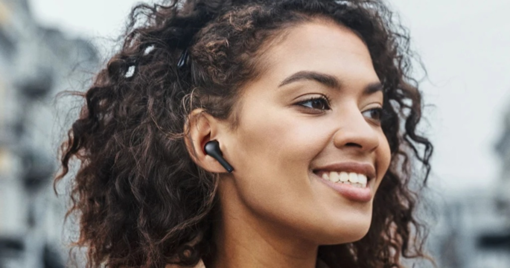 woman wearing aukey earbuds