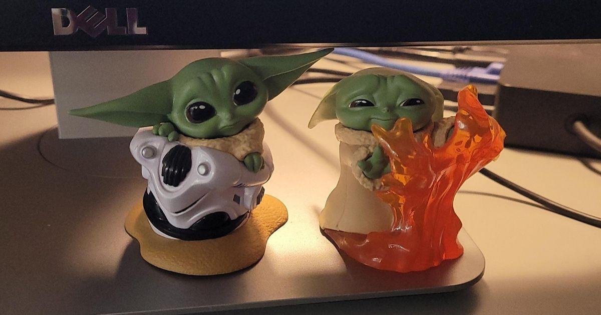 two Baby Yoda figures