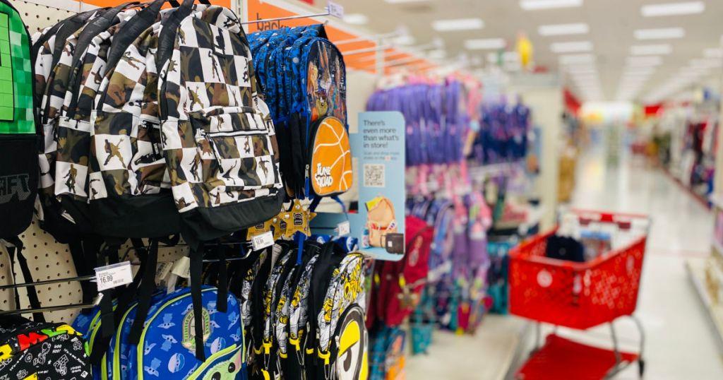 kids' backpacks hanging on shelf