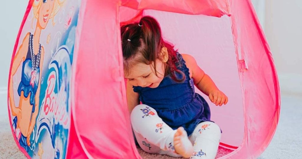 young girl in a Barbie themed tent
