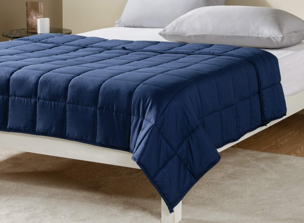 weighted blanket on a bed